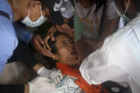 A woman is treated by nurse as she got tear gas during an anti-coup protest in Yangon, Myanmar, Tuesday, March 2, 2021. Demonstrators in Myanmar took to the streets again on Tuesday to protest last month's seizure of power by the military, as foreign ministers from Southeast Asian countries prepared to meet to discuss the political crisis. Police in Yangon, Myanmar's biggest city, used tear gas against the protesters. (AP Photo)