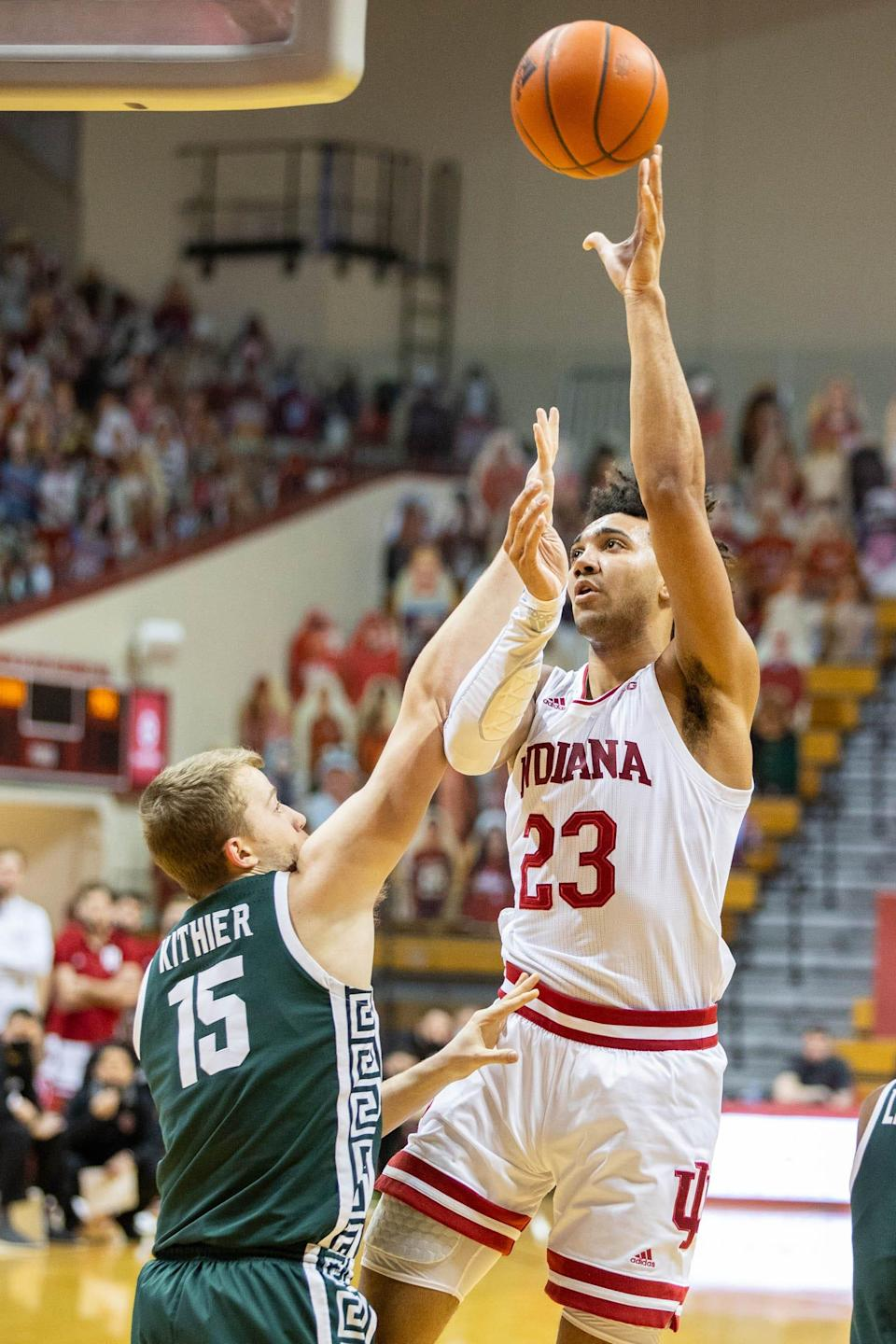Feb 20, 2021; Bloomington, Indiana, USA; Indiana Hoosiers forward Trayce Jackson-Davis (23) shoots the ball over Michigan State Spartans forward Thomas Kithier (15) in the first half at Simon Skjodt Assembly Hall. Mandatory Credit: Trevor Ruszkowski-USA TODAY Sports