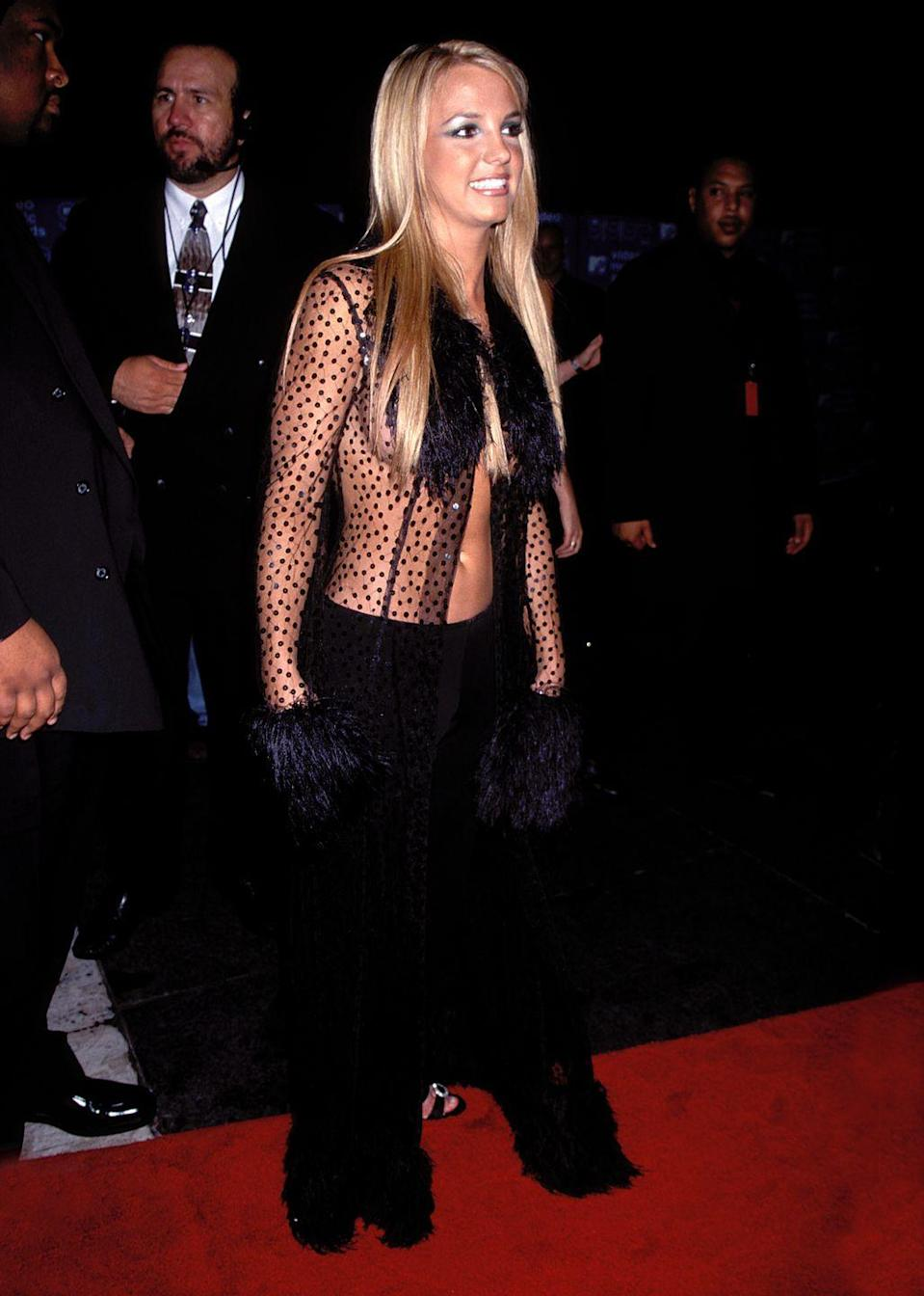 <p>More dramatic eyeshadow circa the 1999 MTV Video Music Awards. Also, there are more marabou feathers on the sleeves of this epic see-through top. </p>