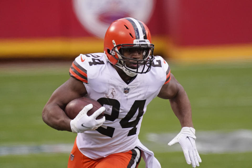 Cleveland Browns running back Nick Chubb carries the ball up field during the second half of an NFL divisional round football game against the Kansas City Chiefs, Sunday, Jan. 17, 2021, in Kansas City. (AP Photo/Charlie Riedel)