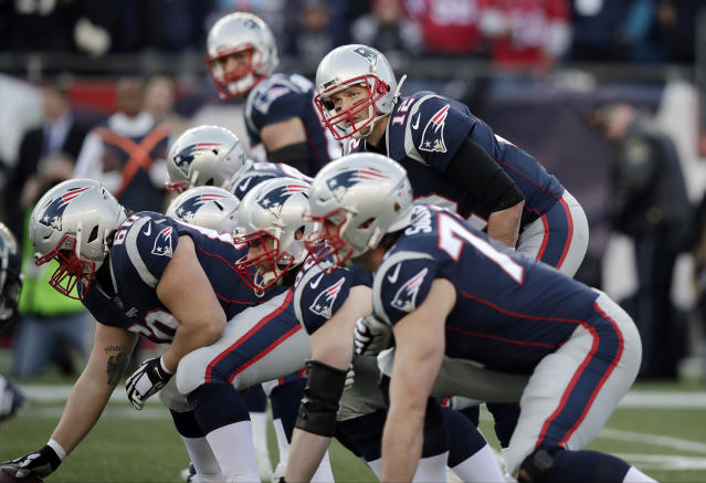 Quarterback Tom Brady had a lesson for his new center. (AP Photo/Charles Krupa)