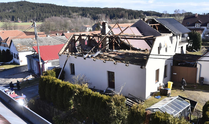 The roof of a house is damaged due to a strong storm in Rohozna, Czech Republic, Monday, Feb. 10, 2020. A storm battered the U.K. and northern Europe with hurricane-force winds and heavy rains Sunday, halting flights and trains and producing heaving seas that closed down ports. Soccer games, farmers' markets and cultural events were canceled as authorities urged millions of people to stay indoors, away from falling tree branches. (Lubos Pavlicek/CTK via AP)
