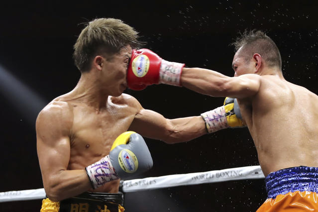 Japan's Naoya Inoue, left, gets a punch from Philippines' Nonito Donaire in the sixth round of their World Boxing Super Series bantamweight final match in Saitama, Japan, Thursday, Nov. 7, 2019. Inoue beat Donaire with a unanimous decision to win the championship. (AP Photo/Toru Takahashi)
