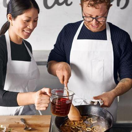 "<p>Help a home cook take their chopping, slicing, and dicing skills to the next level with <a href=""https://www.popsugar.com/buy/Sur-La-Table-cooking-classes-384823?p_name=Sur%20La%20Table%20cooking%20classes&retailer=surlatable.com&pid=384823&price=55&evar1=moms%3Aus&evar9=45564967&evar98=https%3A%2F%2Fwww.popsugar.com%2Fphoto-gallery%2F45564967%2Fimage%2F45565369%2FSur-La-Table-Cooking-Classes&list1=gifts%2Choliday%2Cgift%20guide%2Cgifts%20for%20women%2Cgifts%20for%20men%2Cgifts%20under%20%24100&prop13=api&pdata=1"" rel=""nofollow"" data-shoppable-link=""1"" target=""_blank"" class=""ga-track"" data-ga-category=""Related"" data-ga-label=""http://www.surlatable.com/category/cat2211278/In+Store+Classes"" data-ga-action=""In-Line Links"">Sur La Table cooking classes</a> ($55 and up). Choose from themes such as cast-iron desserts, pasta at home, and Parisian date night.You can even go with them as part of the gift.</p>"