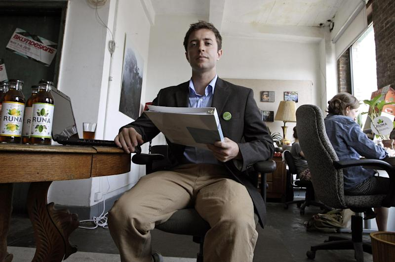 In this photo taken June 11, 2012, Jim Schreiber, 26, is seen at the offices of Runa in New York. Schreiber is responsible for choosing the company's health insurance plan at Runa, a small tea importing company with seven employees. (AP Photo/Kathy Willens)