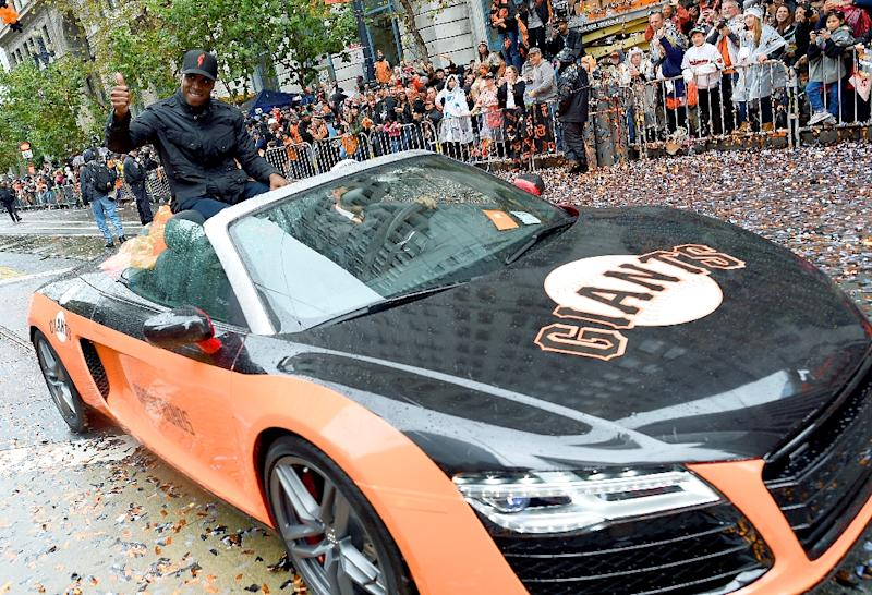 Barry Bonds, former San Francisco Giants great, waves to the crowd along the parade route during the San Francisco Giants World Series victory parade on October 31, 2014 in San Francisco, California