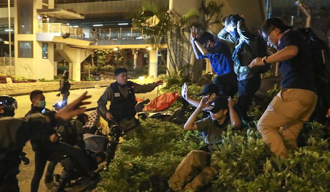 Protesters face arrest while trying to escape from Polytechnic University campus on November 19. Photo: Sam Tsang