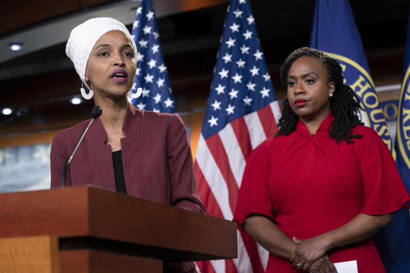 "U.S. Rep. Ilhan Omar, D-Minn., joined at right by U.S. Rep. Ayanna Pressley, D-Mass., responds to remarks by President Donald Trump after he called for four Democratic congresswomen of color to go back to their ""broken"" countries, as he exploited the nation's glaring racial divisions once again for political gain, during a news conference at the Capitol in Washington, Monday, July 15, 2019. All four congresswomen are American citizens and three of the four were born in the U.S. Omar is the first Somali-American in Congress. (AP Photo/J. Scott Applewhite)"