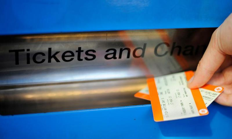 a customer collects rail tickets