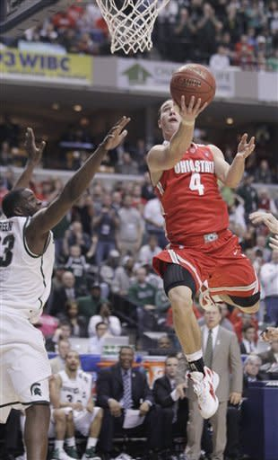 Ohio State guard Aaron Craft (4) goes up for a basket against Michigan State forward Draymond Green in the first half of an NCAA college basketball game in the final of the Big Ten Conference men's tournament in Indianapolis, Sunday, March 11, 2012. (AP Photo/Michael Conroy)