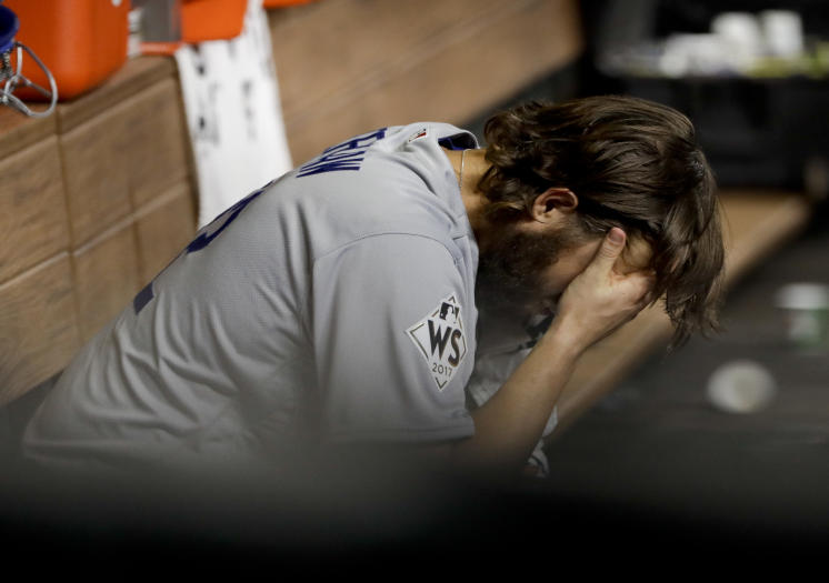 Dodgers starting pitcher Clayton Kershaw sits in the dugout after allowing a three-run homer to Houston's Yuli Gurriel in World Series Game 5. (AP)