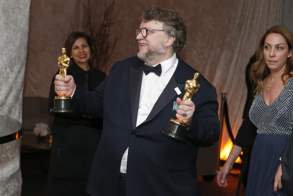 "Guillermo del Toro poses with his awards for best director and best picture for ""The Shape of Water"" at the Governors Ball after the Oscars on Sunday, March 4, 2018, at the Dolby Theatre in Los Angeles. (Photo by Eric Jamison/Invision/AP)"