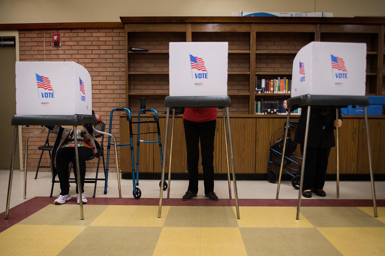 Iva Woke, left, a 100-year-old Maryland resident, joins others in early voting, Oct. 25, 2018. (Photo: Jim Watson/AFP/Getty Images)