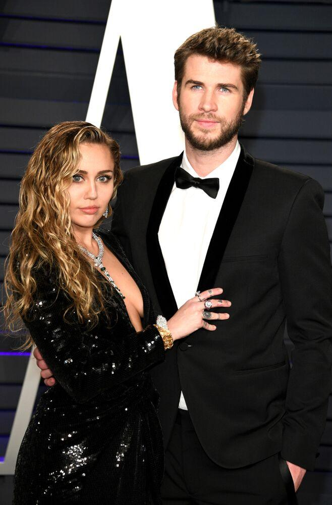 Miley Cyrus and Liam Hemsworth | Daniele Venturelli/WireImage