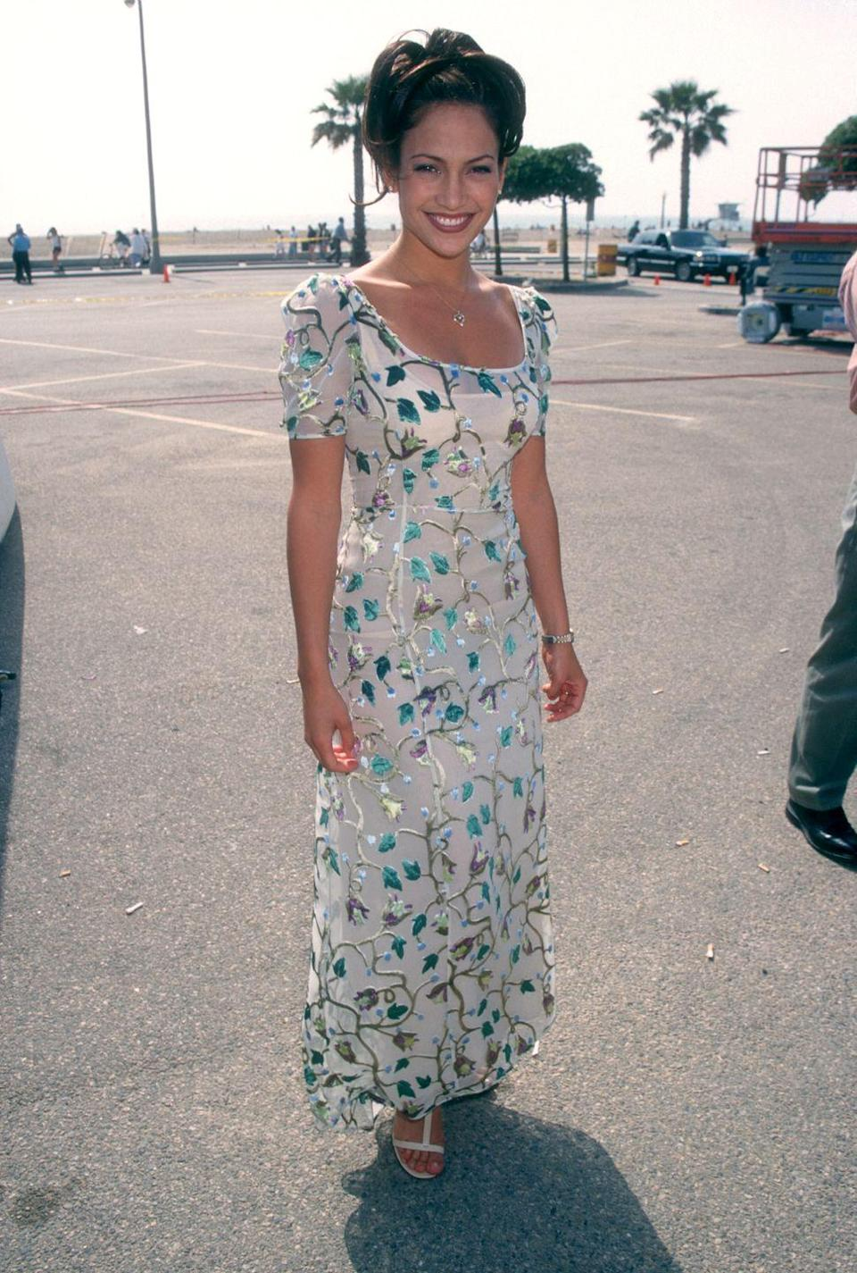 <p>At the beach in a velvet embellished sheer dress with puff sleeves.</p>