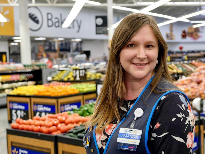 Walmart store People Lead Amanda Nelson graduated from the retailer's $1-a-day college program called Live Better U.