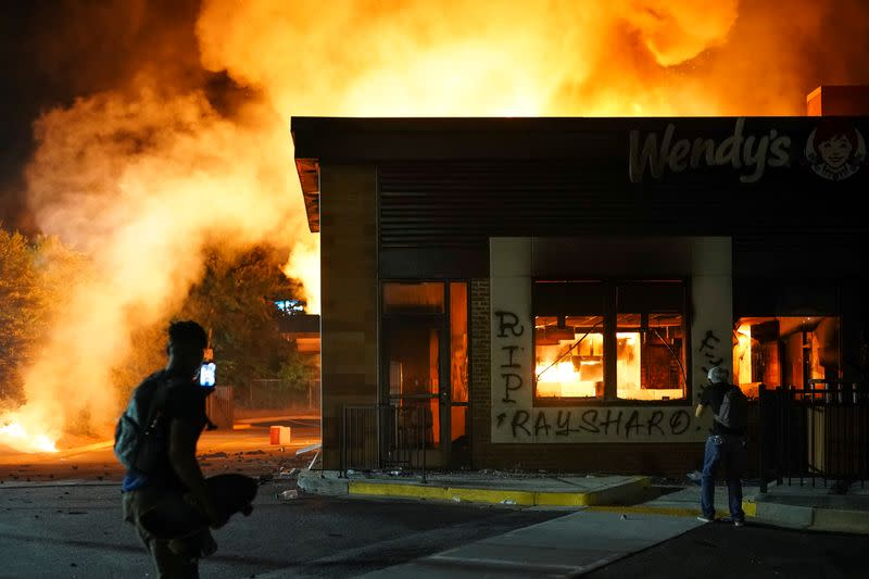 FILE PHOTO: A Wendy's burns following a rally against racial inequality and the police shooting death of Rayshard Brooks, in Atlanta