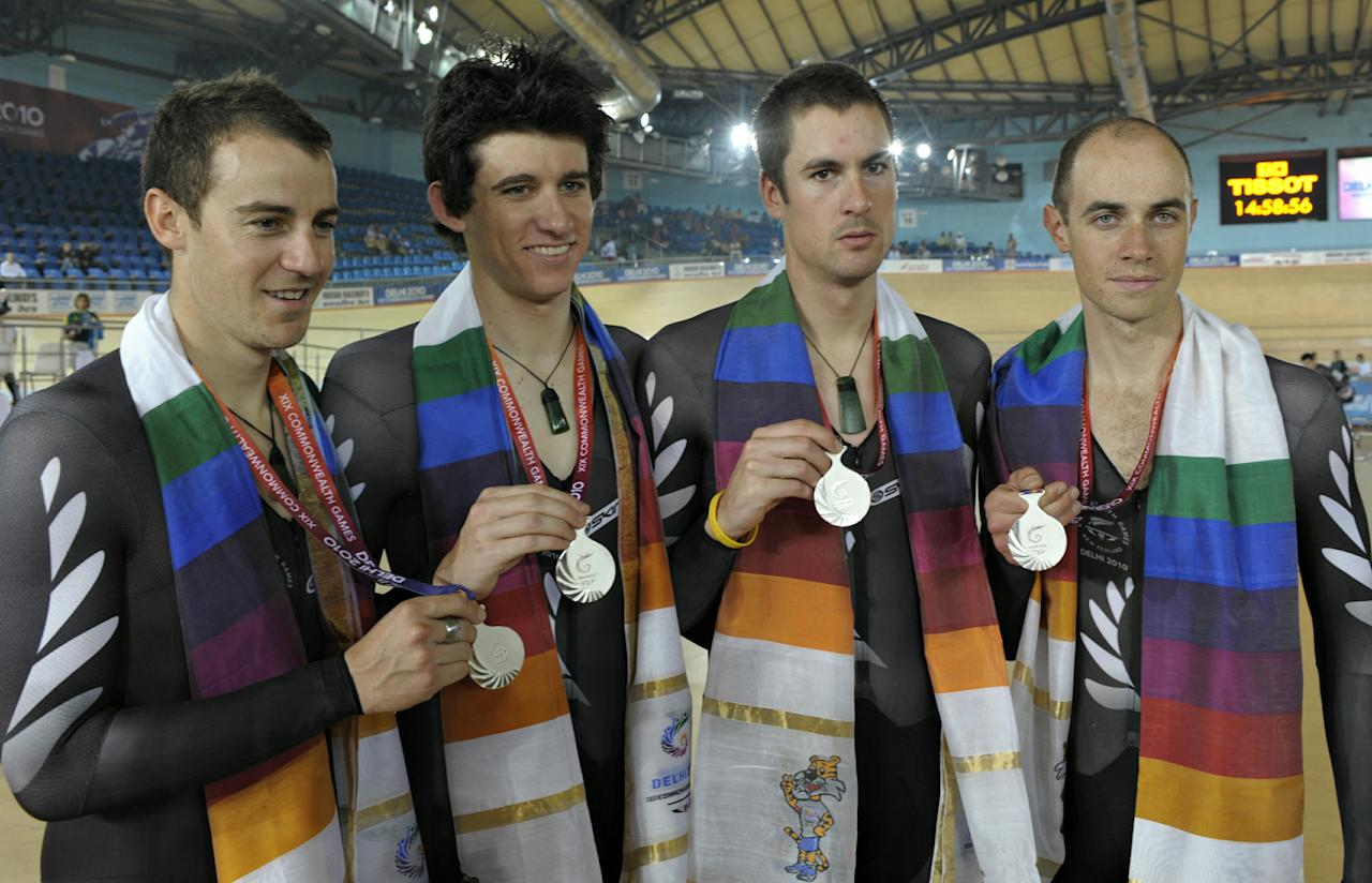 New Zealand cyclists pose with their medals during the men's team pursuit cycling award ceremony at the Indira Gandhi Sports Complex during the XIX Commonwealth Games in New Delhi on October 7, 2010. New Zealand won silver in the event.  AFP PHOTO/Deshakalyan CHOWDHURY (Photo credit should read DESHAKALYAN CHOWDHURY/AFP/Getty Images)
