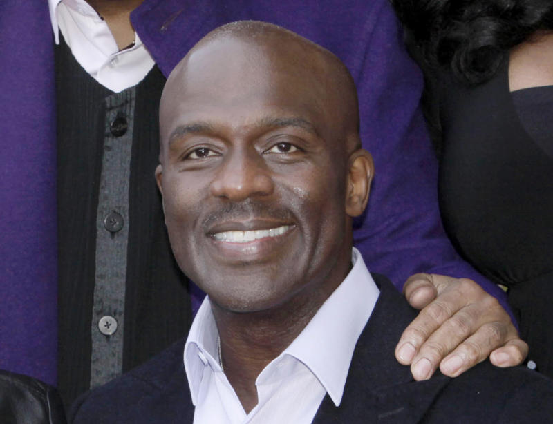 "FILE - This Oct. 20, 2011 file photo shows Bebe Winans poses after he and CeCe Winans received a star on the Hollywood Walk of Fame in Los Angeles.  Winans, who sang at Whitney Houston's funeral, announced Thursday he has written ""The Whitney I Knew,"" due out July 31. The book promises what is described as ""heart-breaking accounts that led to her ultimate defeat."" (AP Photo/Nick Ut, file)"