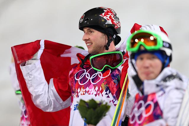 SOCHI, RUSSIA - FEBRUARY 10: Gold medalist Alex Bilodeau of Canada (L) celebrates during the flower ceremony for the Men's Moguls Finals on day three of the Sochi 2014 Winter Olympics at Rosa Khutor Extreme Park on February 10, 2014 in Sochi, Russia. (Photo by Mike Ehrmann/Getty Images)