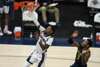 Gonzaga's Joel Ayayi (11) shoots in front of West Virginia's Gabe Osabuohien during the second half of an NCAA college basketball game Wednesday, Dec. 2, 2020, in Indianapolis. (AP Photo/Darron Cummings)