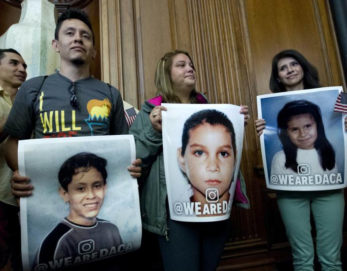 """<span class=""""caption"""">Three DACA recipients hold pictures of themselves as children newly arrived in the United States at a congressional meeting, Sept. 6, 2017.</span> <span class=""""attribution""""><a class=""""link rapid-noclick-resp"""" href=""""https://newsroom.ap.org/detail/CongressImmigration/410c1865769b4e8e8e68869c9a68fbbb/photo?Query=daca%20AND%20dreamer&mediaType=photo&sortBy=arrivaldatetime:desc&dateRange=Anytime&totalCount=87&currentItemNo=61"""" rel=""""nofollow noopener"""" target=""""_blank"""" data-ylk=""""slk:Jose Luis Magan/AP Photo"""">Jose Luis Magan/AP Photo</a></span>"""