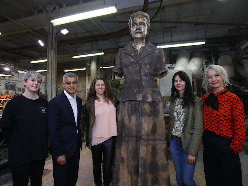 Technician Chloe Hughes, Sadiq Khan, Caroline Criado-Perez, artist Gillian Wearing and Justine Simons, during a visit to AB Fine Art Foundry in east London to see the finishing touches being put to the artwork (PA)