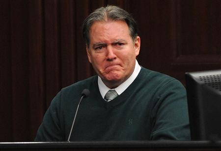 Defendant Michael Dunn reacts on the stand during testimony in his own defense during his murder trial in Duval County Courthouse in Jacksonville, Florida February 11, 2014. REUTERS/Bob Mack/Pool