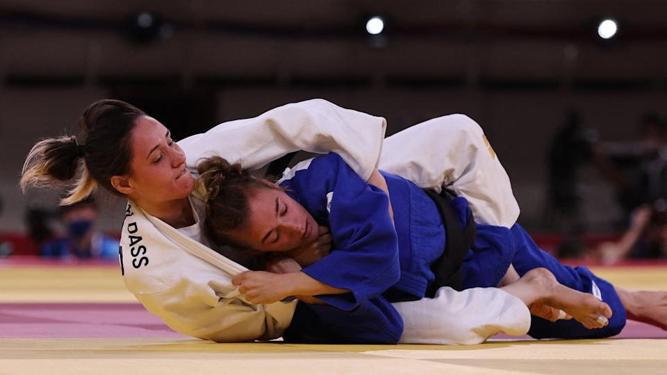 Refugee Olympic Team's Sanda Aldass (white) fights Serbia's Marica Perisic. (Photo by JACK GUEZ/AFP via Getty Images)