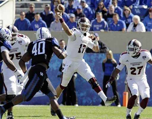 Mississippi State quarterback Tyler Russell (17) makes as jump pass against Kentucky during the first half of an NCAA college football game in Lexington, Ky., Saturday, Oct. 6, 2012. At right is Mississippi State running back LaDarius Perkins (27) protecting the quarterback. (AP Photo/Garry Jones)