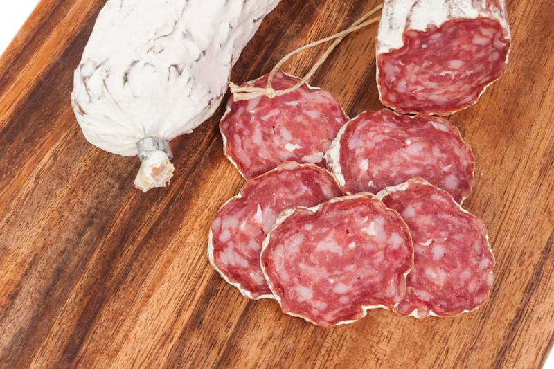 salami sausage on wooden board background