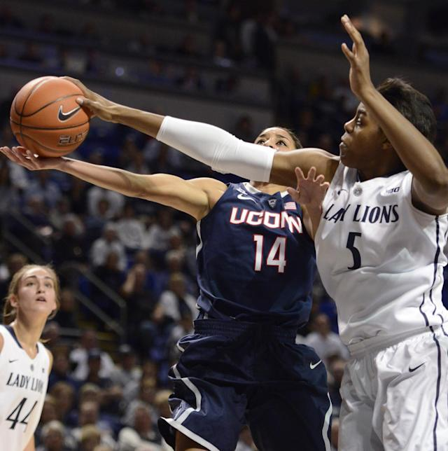 Penn State's Talia East (5) blocks a shot by Connecticut's Bria Hartley (14) in the first half of an NCAA college basketball game, Sunday, Nov. 17, 2013, in State College, Pa. (AP Photo/John Beale)