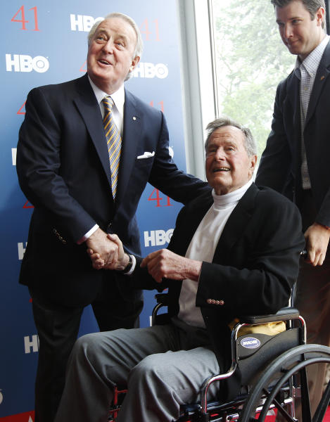 "President George H.W. Bush, right, shakes hands with former Canadian Prime Minister Brian Mulroney as they arrive for the premiere of HBO's new documentary on the president's life in Kennebunkport, Maine, Tuesday, June 12, 2012. The premiere of ""41"" was held Tuesday on Bush's 88th birthday on the grounds of St. Ann's Church in Kennebunkport, near the Bush family's summer home.(AP Photo/Charles Krupa)"