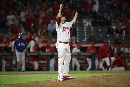 Los Angeles Angels relief pitcher Hansel Robles celebrates after the team's 4-1 win over the Texas Rangers in a baseball game in Anaheim, Calif., Tuesday, Sept. 25, 2018. (AP Photo/Chris Carlson)