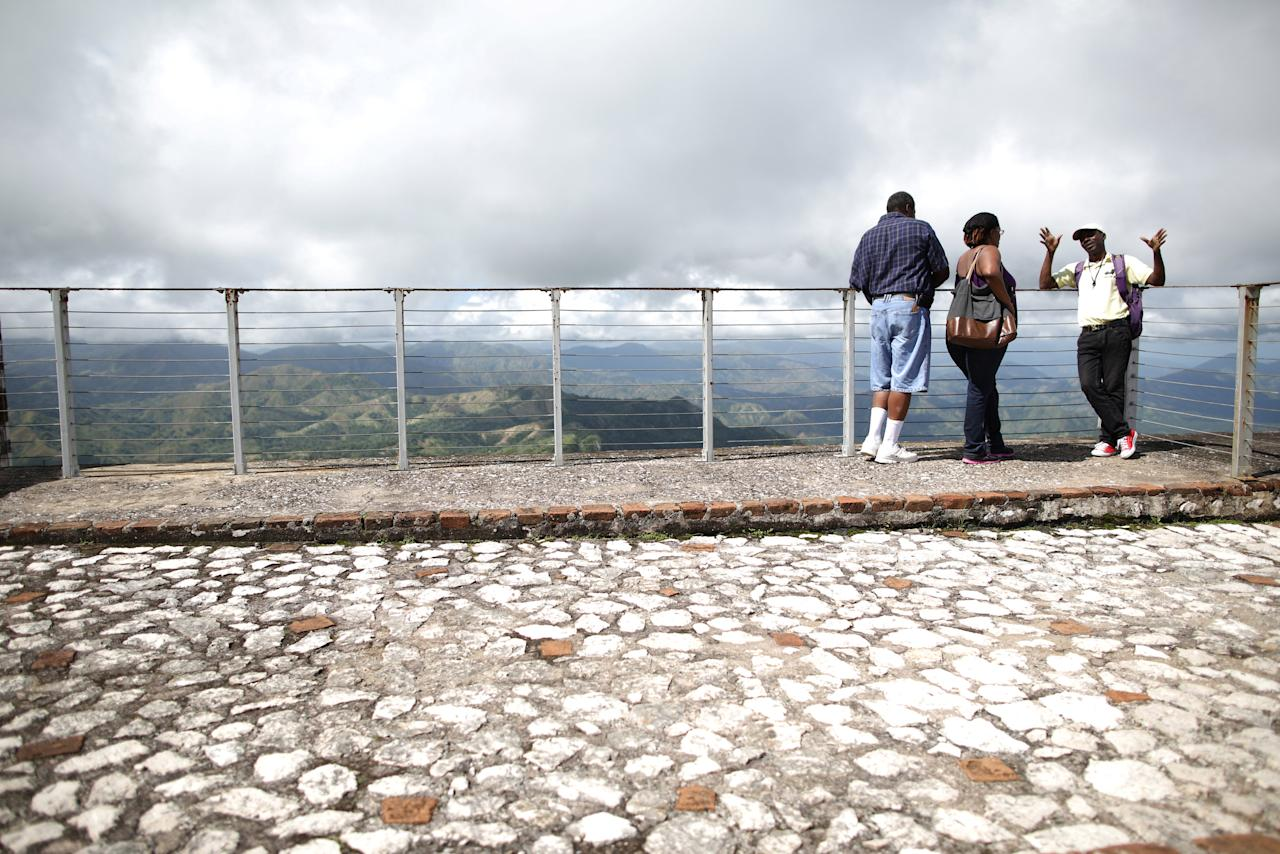 American tourists Janet Moore and Leonard Moore attend to the explanations of a local guide as they visit the Citadel Laferriere in Milot, Haiti, November 19, 2017. The Citadel Laferriere is one of the main touristic attractions in Haiti and it is considered a World Heritage Site according to United Nations Educational, Scientific and Cultural Organization (UNESCO). REUTERS/Andres Martinez Casares