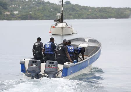 Members of Jamaica's Marine Police leave the port to join in the search for a small U.S. private plane with an unresponsive pilot that crashed off the east coast of Jamaica, in Port Antonio September 6, 2014. REUTERS/Gilbert Bellamy