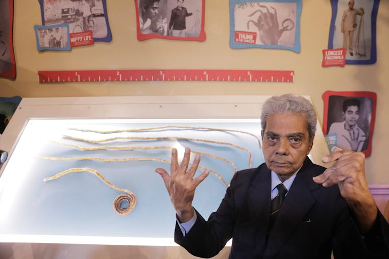 Shridhar Chillal of India displays his newly cut fingernails at an announcement that the five fingernails he grew for 66 years will be displayed in Ripley's Believe it or Not in New York.
