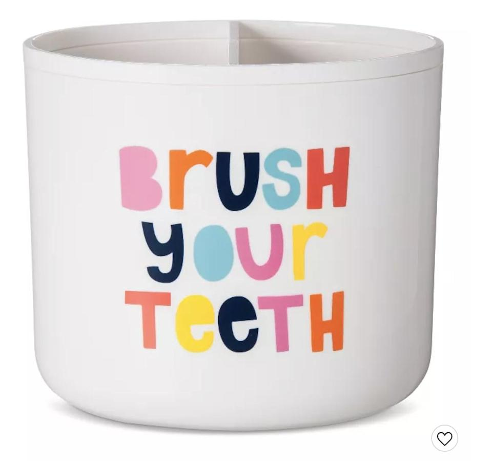 """<p>There's no way you'll forget this important step in your morning routine with the bright rainbow message on the <span>Target Pillowfort """"Brush Your Teeth"""" Toothbrush Holder</span> ($9).</p>"""