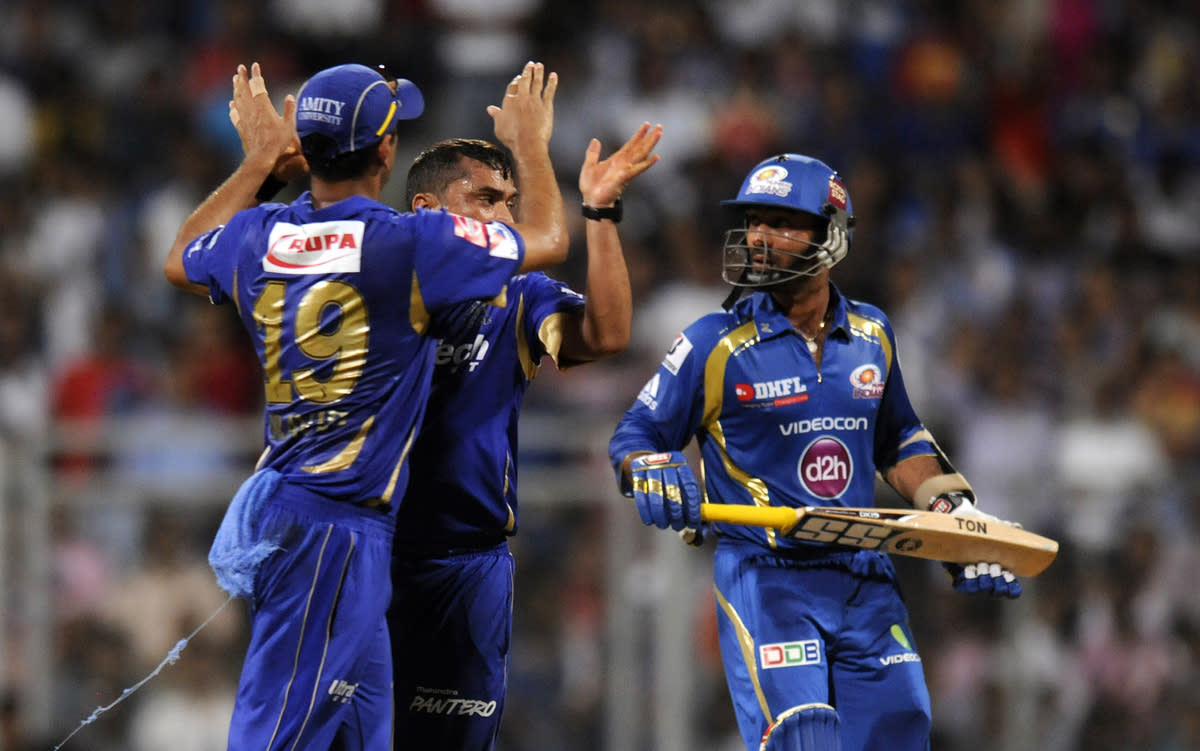 Pravin Tambe of Rajasthan Royals celebrates the wicket of Dinesh Karthik of Mumbai Indians during match 66 of the Pepsi Indian Premier League ( IPL) 2013  between The Mumbai Indians and the Rajasthan Royals held at the Wankhede Stadium in Mumbai on the 15th May 2013 ..Photo by Pal Pillai-IPL-SPORTZPICS ..Use of this image is subject to the terms and conditions as outlined by the BCCI. These terms can be found by following this link:..https://ec.yimg.com/ec?url=http%3a%2f%2fwww.sportzpics.co.za%2fimage%2fI0000SoRagM2cIEc&t=1506215713&sig=uRD9q6Au4.Gzp2fXuhT6Xg--~D