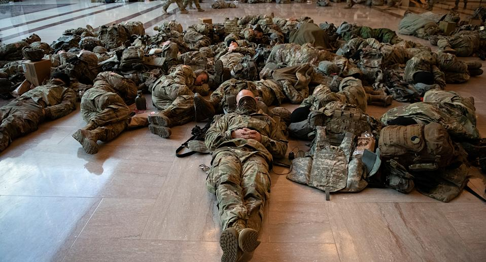 Soldiers lying on the floor. Source: AP