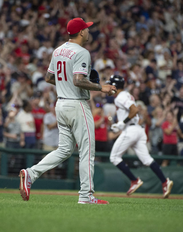 Philadelphia Phillies starting pitcher Vince Velasquez (21) walks from the mound as Cleveland Indians' Oscar Mercado rounds the bases after hitting a three-run home run during the fifth inning of a baseball game in Cleveland, Sunday, Sept. 22, 2019. (AP Photo/Phil Long)