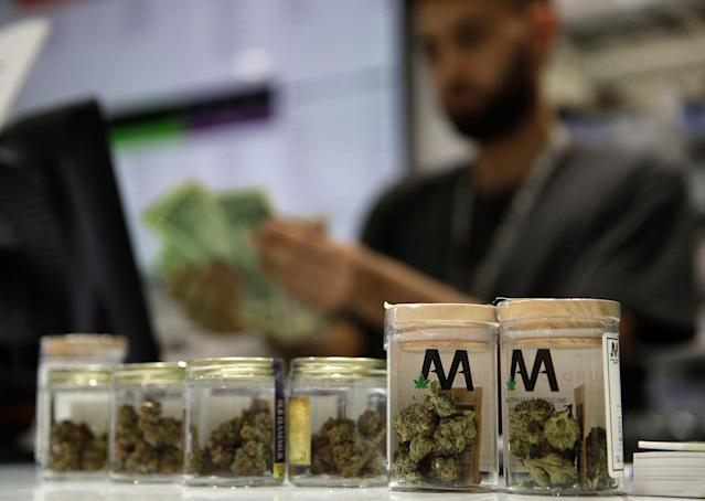 <p>A cashier rings up a marijuana sale at the Essence cannabis dispensary, Saturday, July 1, 2017, in Las Vegas, Nev. (Photo: John Locher/AP) </p>