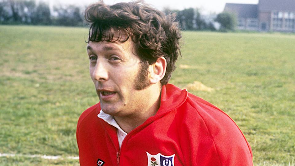 Pictured here, John Dawes stops for a chat after a rugby match.
