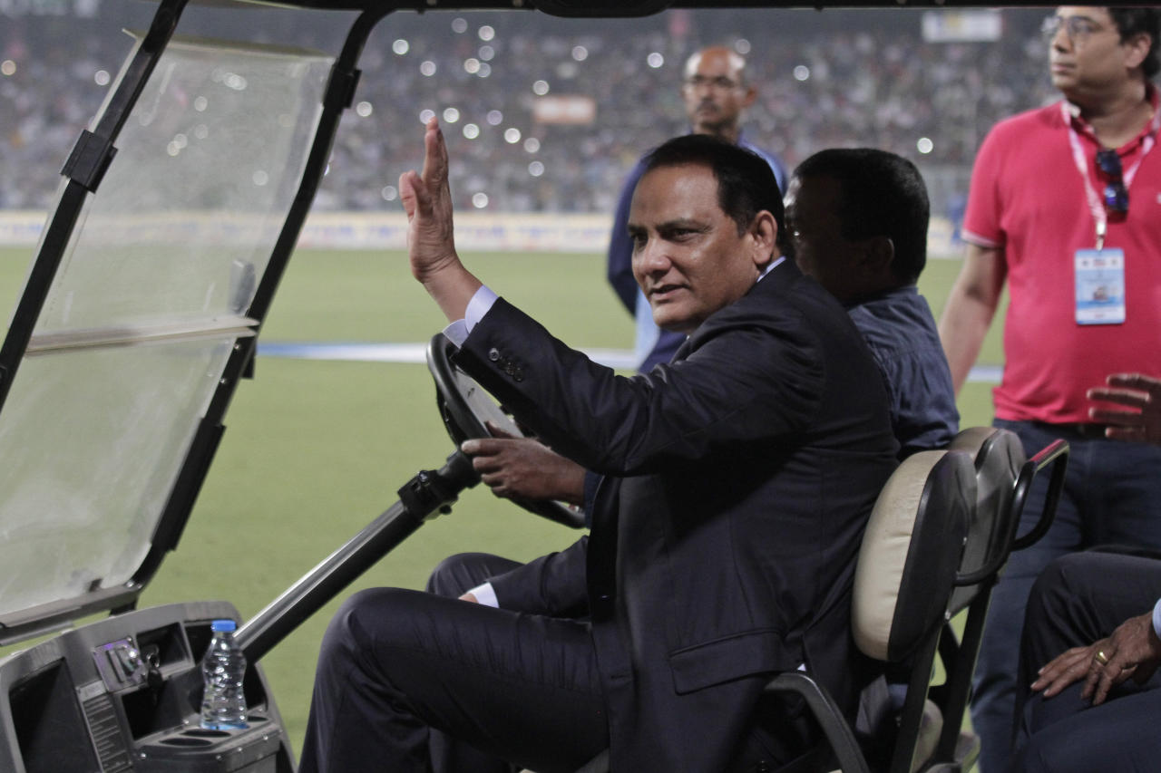 Former Indian cricketer Mohammad Azharuddin acknowledges the crowd during a grand parade of India's former cricket captains during the first day of the second test match between India and Bangladesh, in Kolkata, India, Friday, Nov. 22, 2019. (AP Photo/Bikas Das)