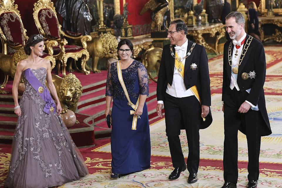 <p>For one of her more formal looks, the Queen selected a lilac, embroidered gown with a matching purple sash and delicate tiara. </p>