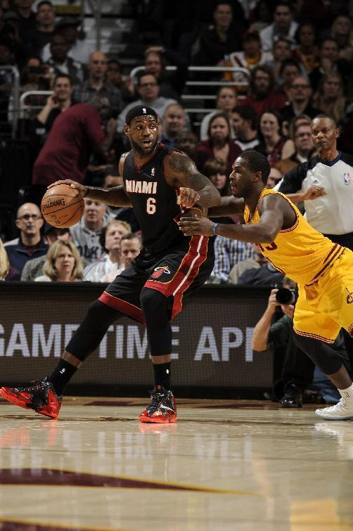 CLEVELAND, OH - NOVEMBER 27: LeBron James #6 of the Miami Heat backs in towards the basket against the Cleveland Cavaliers at The Quicken Loans Arena on November 27, 2013 in Cleveland, Ohio. (Photo by David Liam Kyle/NBAE via Getty Images)