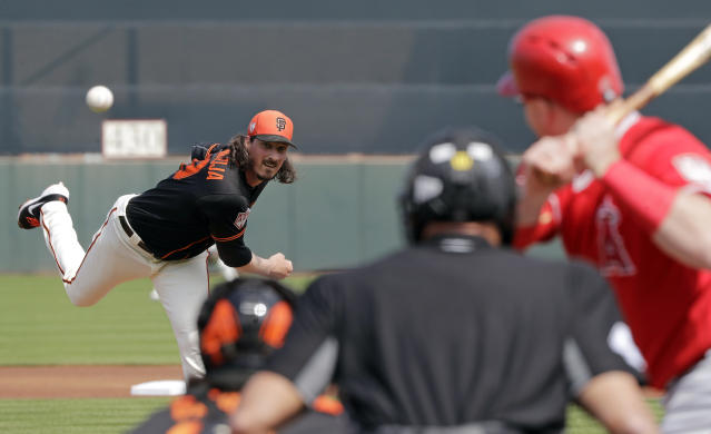 San Francisco Giants starting pitcher Jeff Samardzija throws to Los Angeles Angels' Justin Bour in the first inning of a spring training baseball game Friday, March 15, 2019, in Phoenix. (AP Photo/Elaine Thompson)