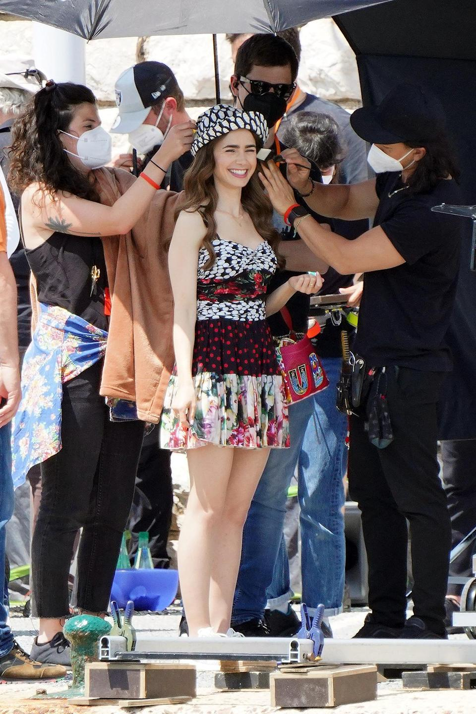 <p>Lily Collins was all smiles while filming a scene for series 2 of <em>Emily In Paris</em> in Saint-Tropez.</p>