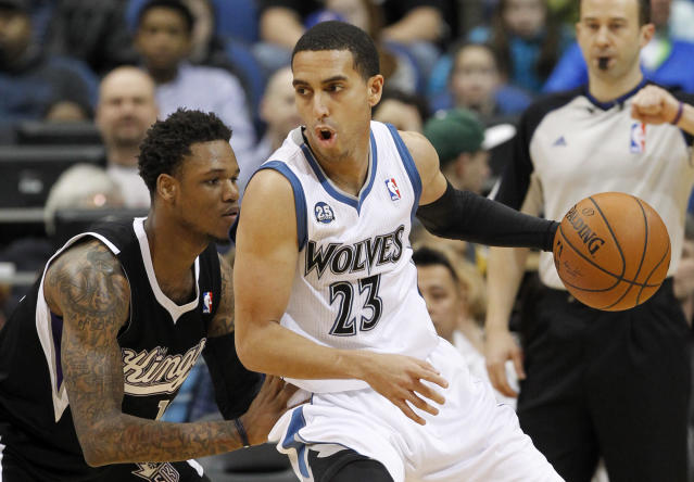 Minnesota Timberwolves guard Kevin Martin (23) drives to the basket against Sacramento Kings guard Ben McLemore, left, during the first quarter of an NBA basketball game in Minneapolis, Sunday, March 16, 2014. (AP Photo/Ann Heisenfelt)
