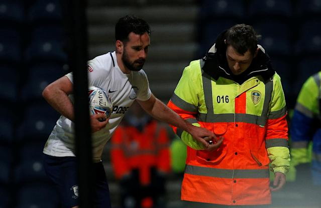 """Soccer Football - Championship - Preston North End vs Leeds United - Deepdale, Preston, Britain - April 10, 2018 Preston North End's Alan Browne hands an object to a steward that was thrown onto the pitch during the game Action Images/Craig Brough EDITORIAL USE ONLY. No use with unauthorized audio, video, data, fixture lists, club/league logos or """"live"""" services. Online in-match use limited to 75 images, no video emulation. No use in betting, games or single club/league/player publications. Please contact your account representative for further details."""